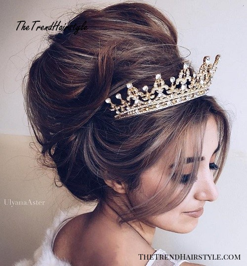 messy beehive wedding updo with tiara