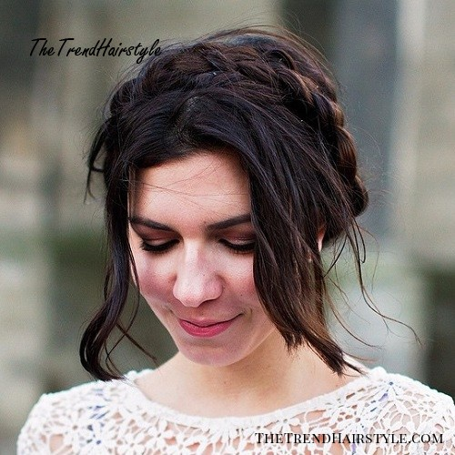 messy brunette milkmaid braid updo