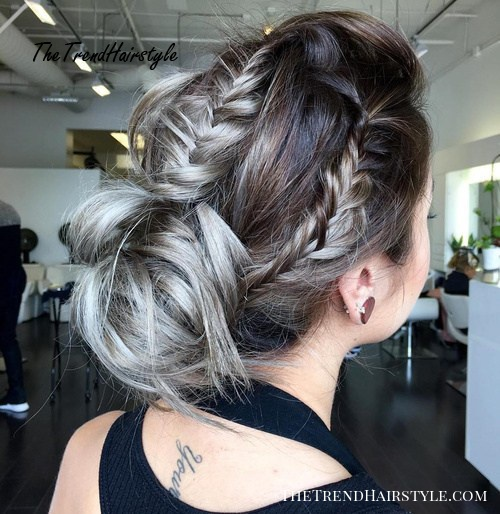 messy bun updo with three fishtails