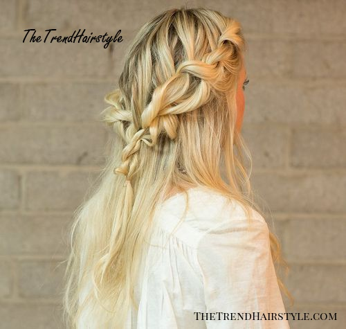 messy loose half up braided hairstyle
