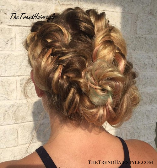 messy updo with two fishtail braids