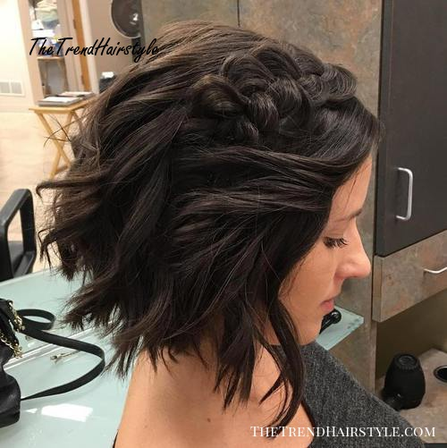 messy waves and a braid formal bob hairstyle
