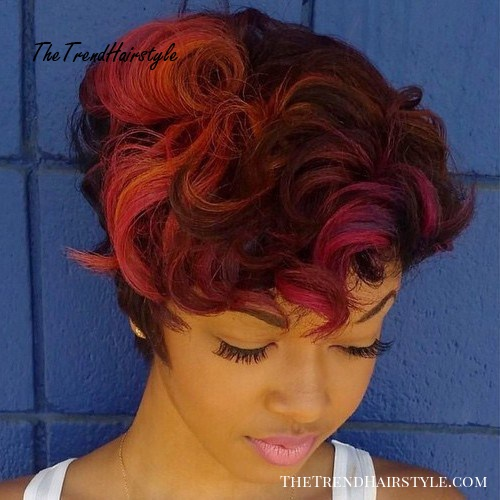 short choppy hairstyle with pink and orange highlights