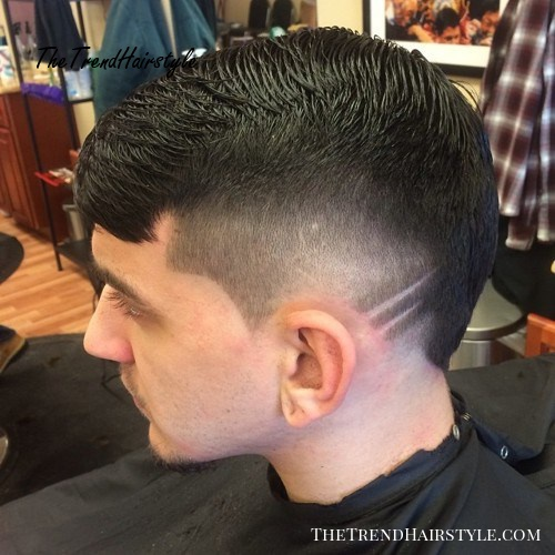 short tapered haircut with faded sides