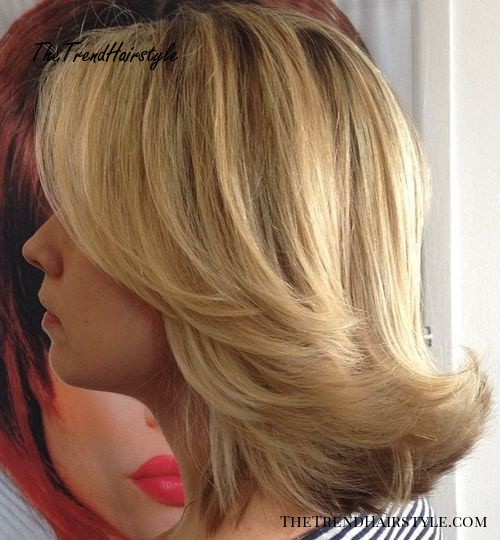 shoulder length flipped back straight hairstyle