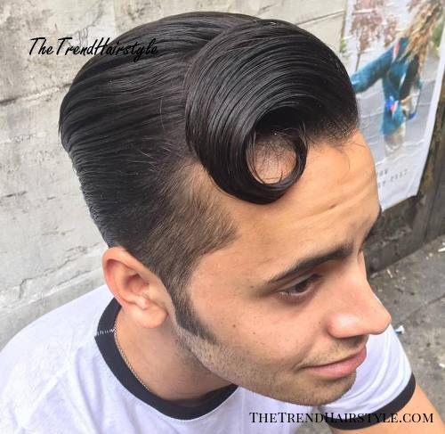 sleek hipster men's hairstyle with sideburns