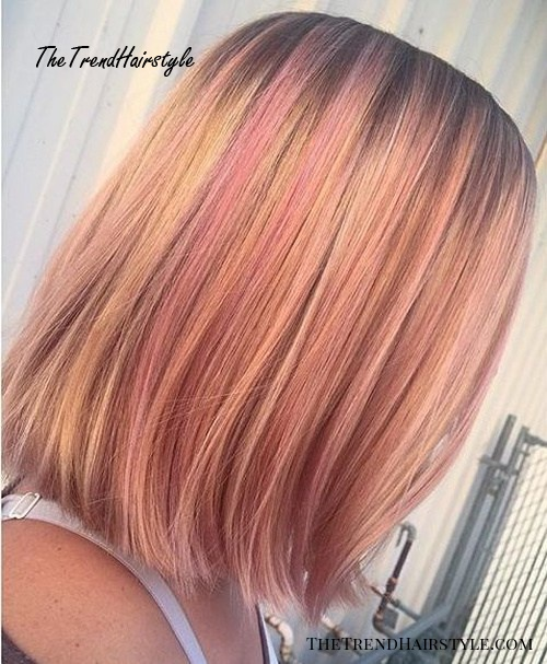 strawberry blonde bob with pastel pink highlights