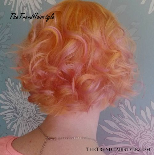 strawberry blonde hair with pastel pink highlights