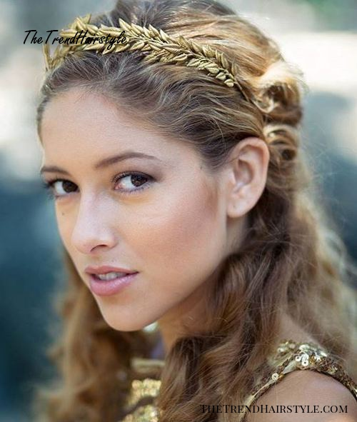 wavy hairstyle with a golden leafed headband